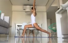 Hot chick doing yoga in white swimsuit