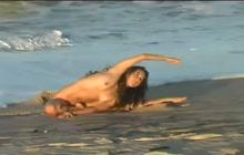 Cute naked girl on the beach
